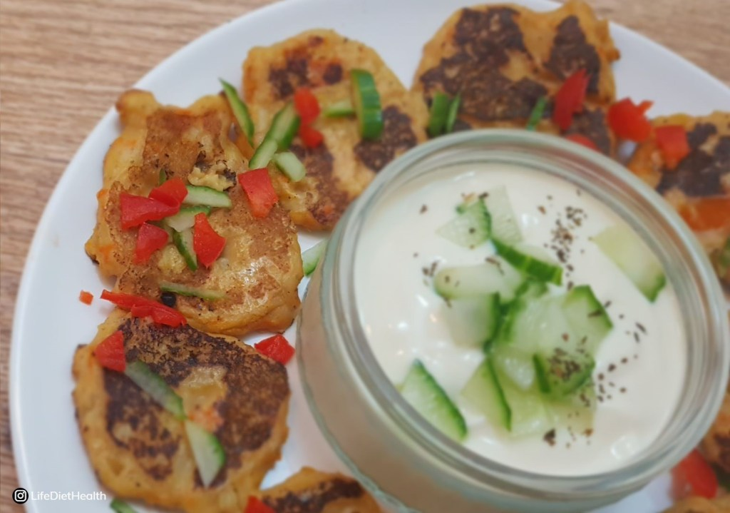 Close up of vegetable fritters with dip