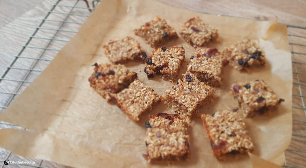 carrot cake flapjack on a sheet of greaseproof paper