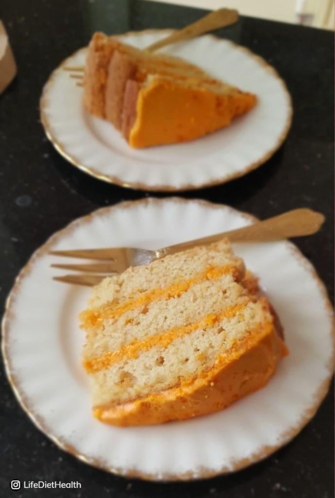 three layers of sponge cake with orange icing
