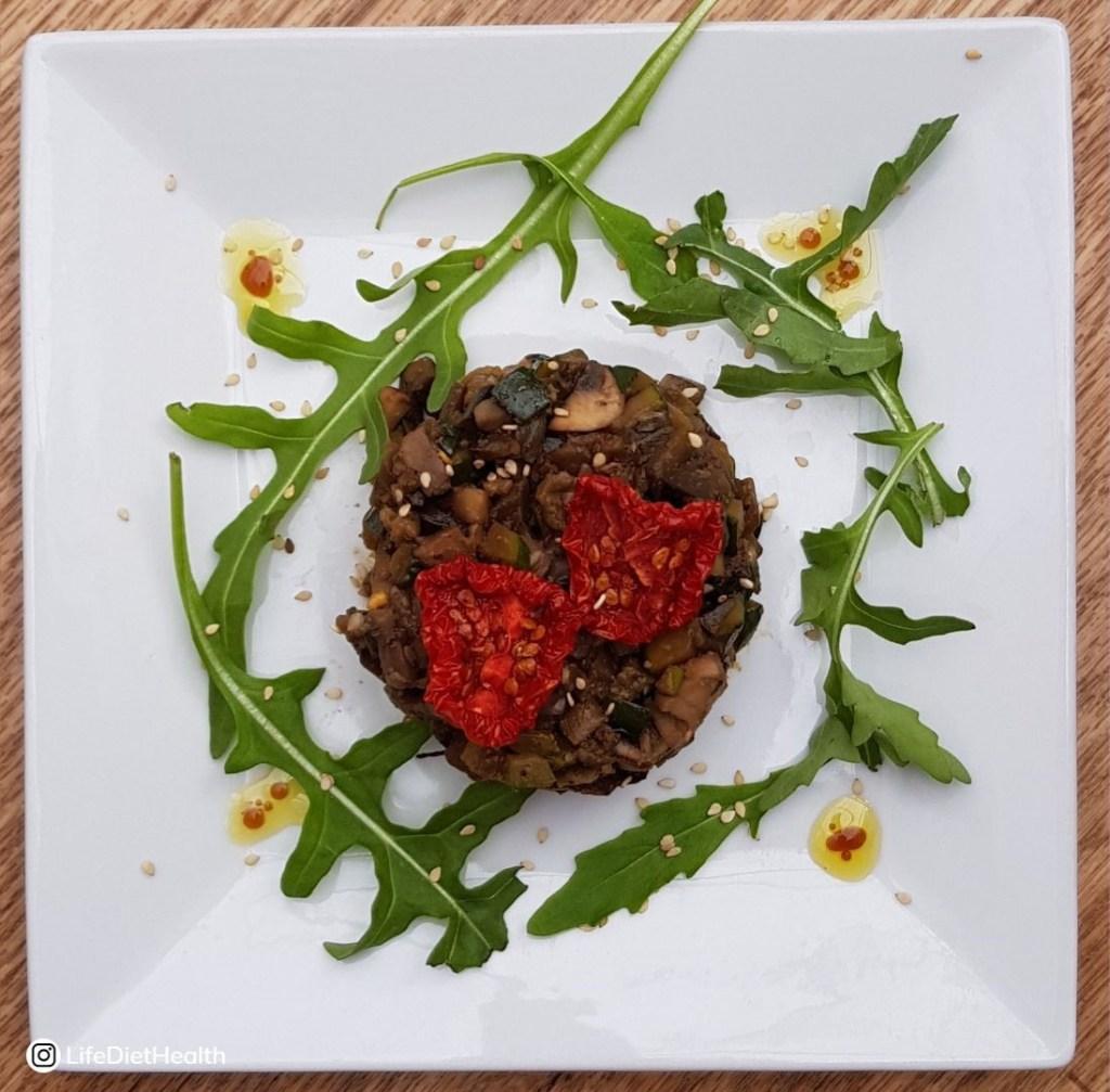 white plate with aubergine in centre