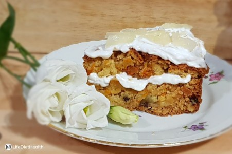tropical vegan cake on a plate with white flowers