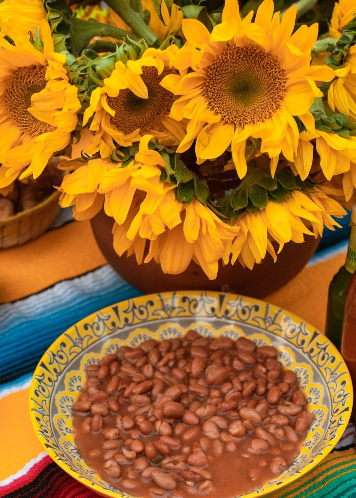 Bowl of pinto beans with sunflowers