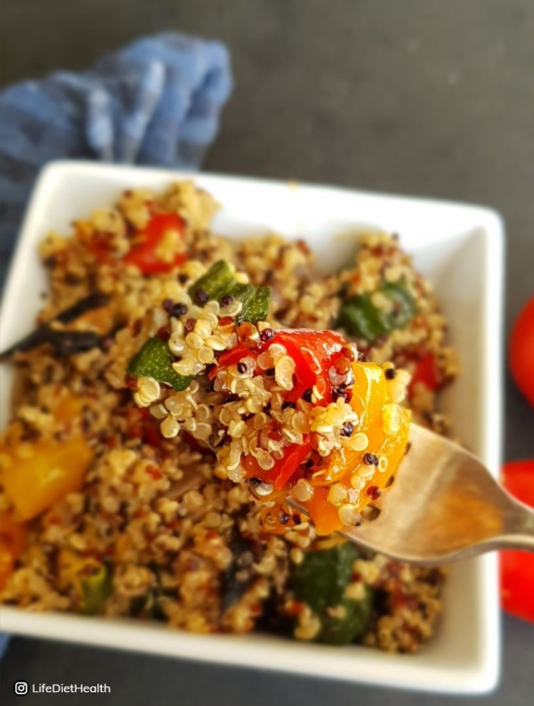 quinoa and roasted vegetableson a fork