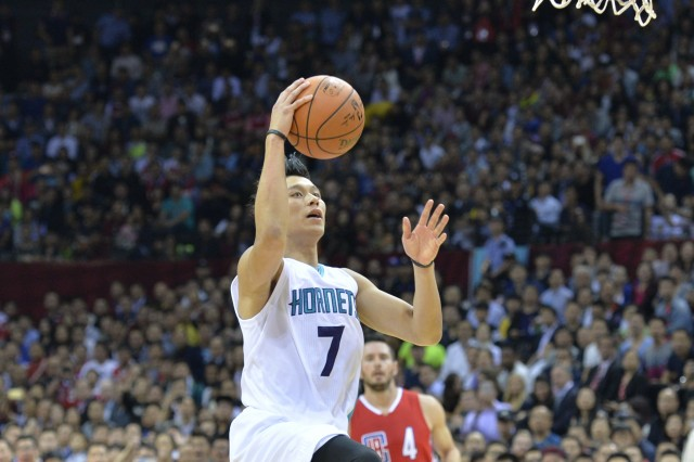 NBA basketball star Jeremy Lin of Charlotte Hornets drives to the basket against Los Angeles Clippers in a match during the 2015 NBA China Games in Shenzhen city, south China's Guangdong province--- Image by © Imaginechina/Corbis