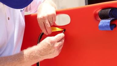 How to Attach the Strap to the Emmobilize™ Rescue 7 (ER7) Plastic Backboard