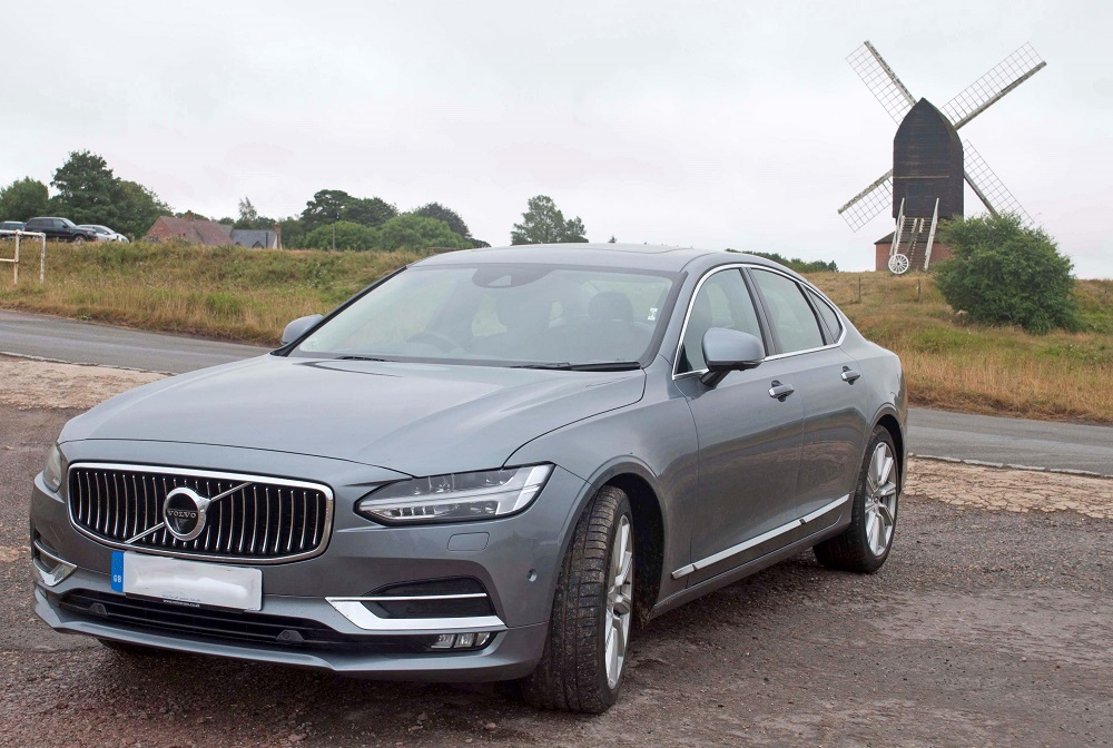 Volvo S90 pictured in front of a windmill