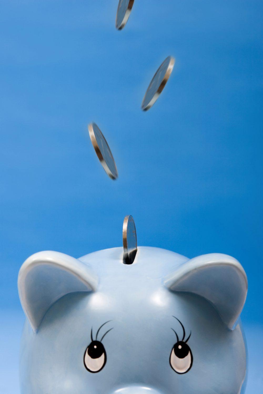 Pennies Falling into a Piggy Bank