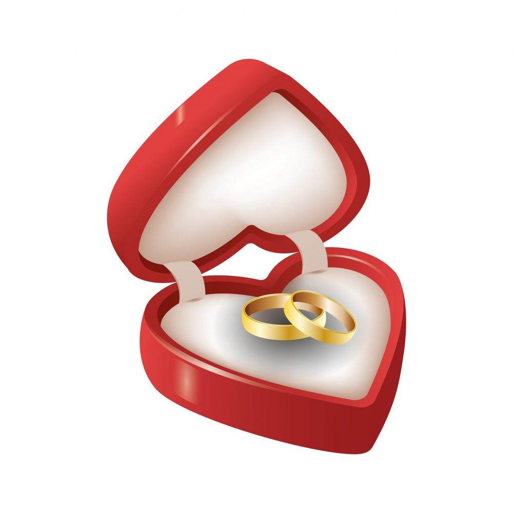 Vector of two gold rings in a heart shaped box