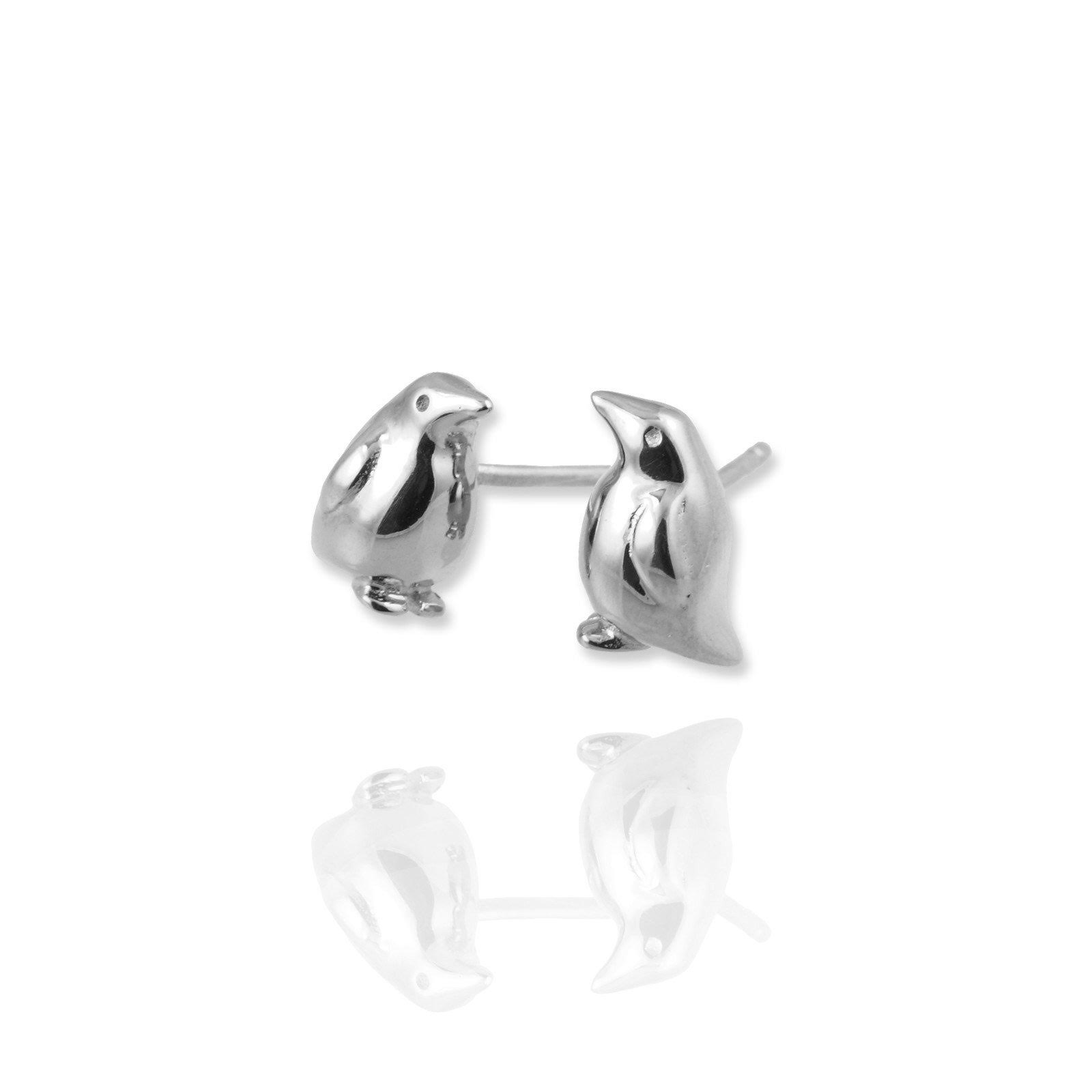 penguin earrings close up