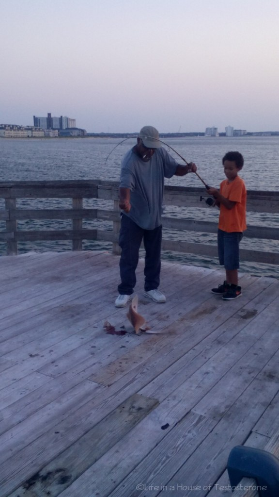 Dad Helping Tre Pull In His Catch