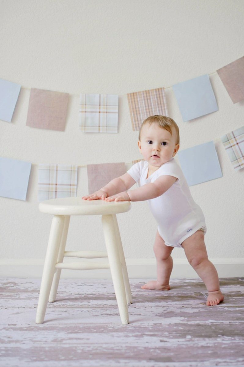 baby standing at stool