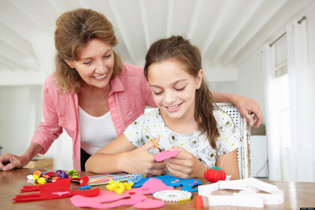 kid crafting with mom