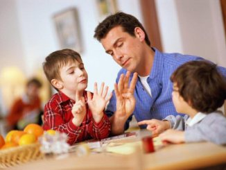 dad homeschooling his children
