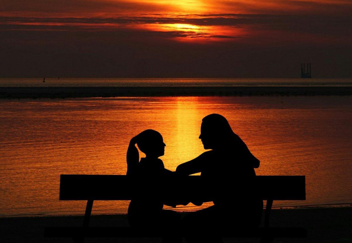 child and parent, sunset