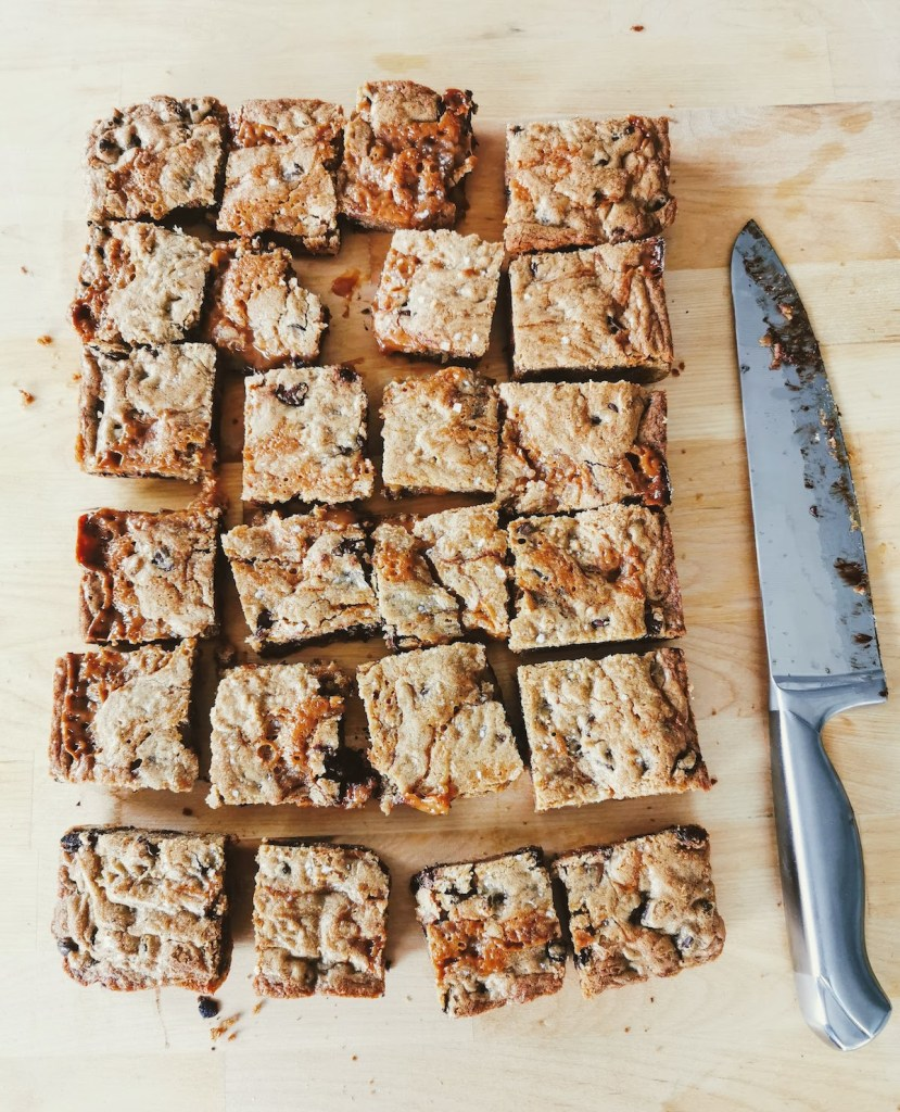 browned butter salted caramel chocolate chip blondies cut and ready to freeze individually