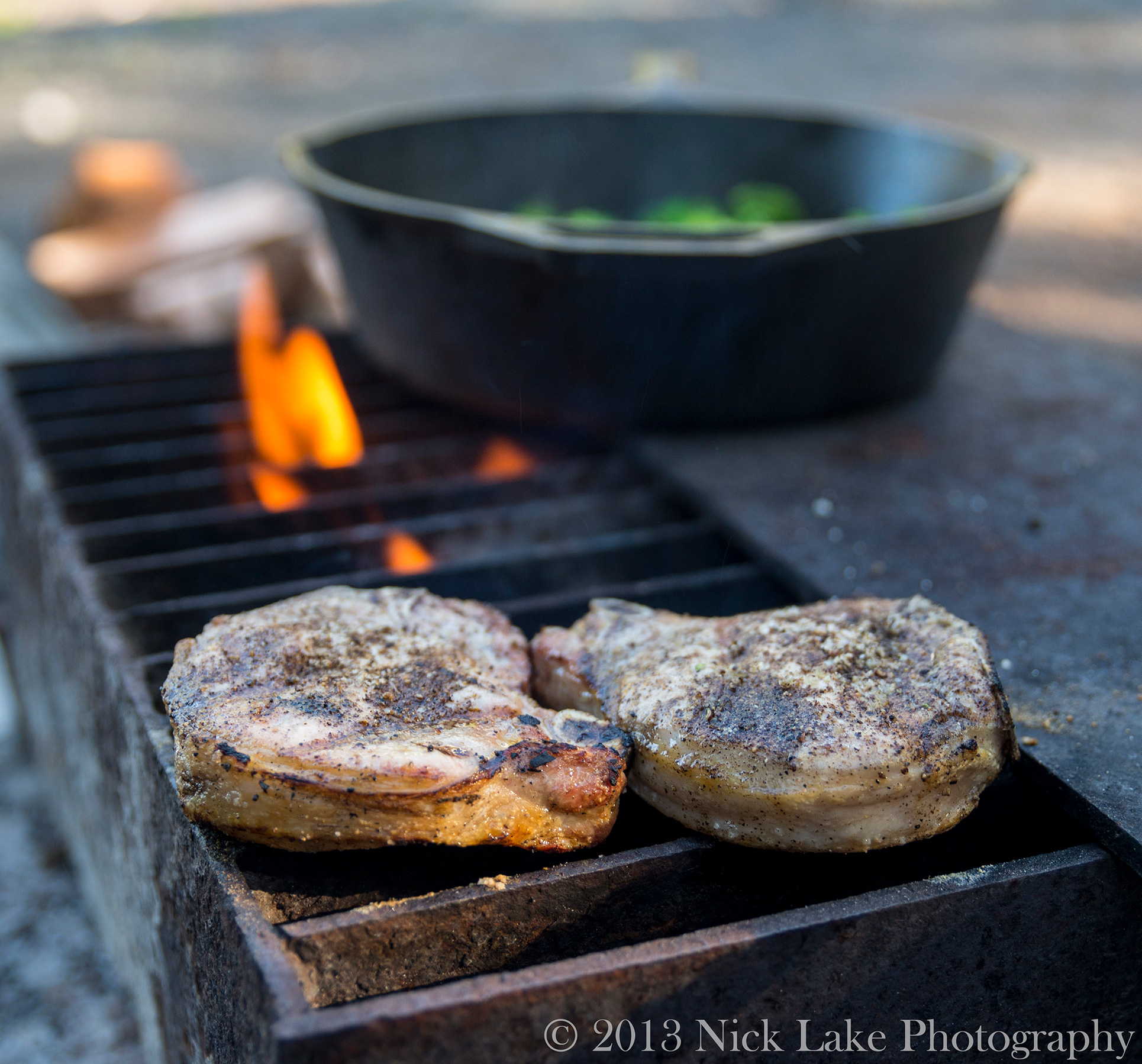 Tasty Pork Chops sizzle on the fire grate
