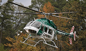 LifeNet Air Medical Helicopter lands with fall leaves in the background.