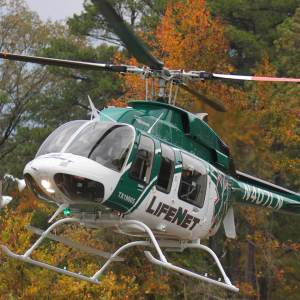 LifeNet Air Medical Helicopter Ambulance Landing in Tress in the Fall in Texarkana