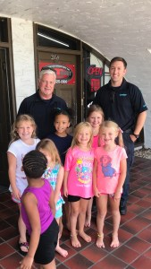 LifeNet Hot Springs EMS pose with kids at Tumble Jungle after doing an ambulance tour.