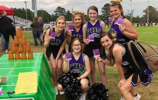 Fouke High School Panther Cheerleaders show their BEFAST magnets at the Stroke Zone setup by LifeNet EMS in Arkansas.