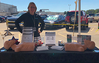 LifeNet Director of PR, Tina Bell, teaches bystander CPR at the Graphic Packaging Health and Wellness Fair in Queen City, Texas.