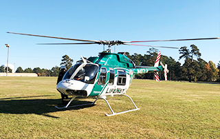 LifeNet Air medical helicopter lands at Spring Lake Park in Texarkana for the 5th Annual Turkey Trot fundraiser for Community Healthcore.