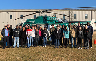 Coach Brown's 8th Grade Career Development Class at Malvern Middle School stands in front of the LifeNet Air medical helicopter in Malvern, Arkansas.