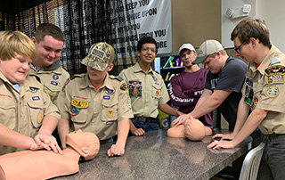 Texarkana Boy Scouts learn how to do bystander CPR during a demonstration from LifeNet EMS to help them earn a merit badge.