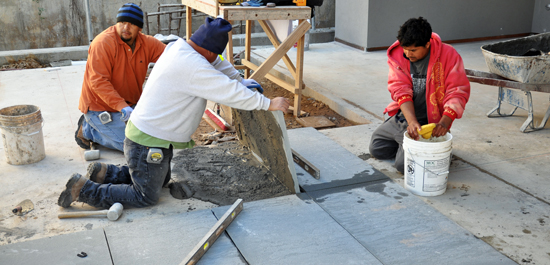 laying Bluestone pavers