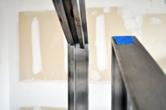 modern stairs - stainless steel handrail spot welds