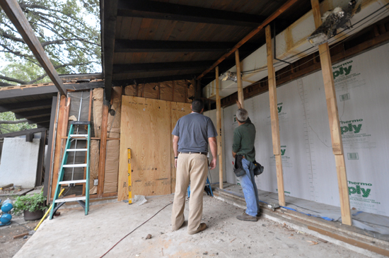 inspeciting future home of a wood header at soffit