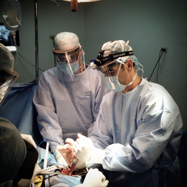 Bob Borson assisting in a hip replacement surgery