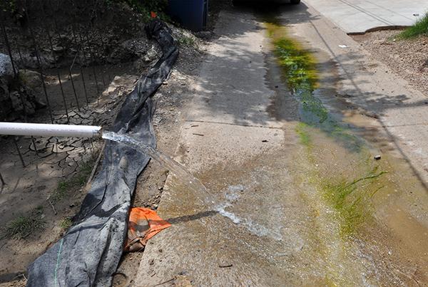 Sump pump discharging water