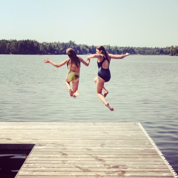 Kate and Mo jumping off a dock