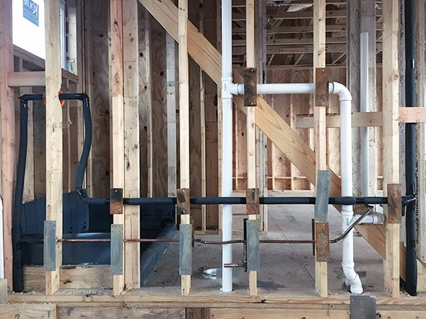 protecting wires and pipes in wood framing