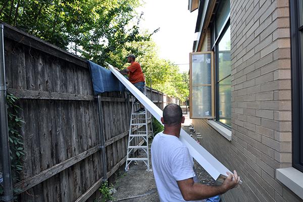 sliding shelves over the neighbors fence