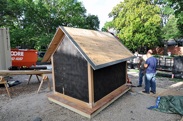 The Cottage House installing the flashing for the metal roof