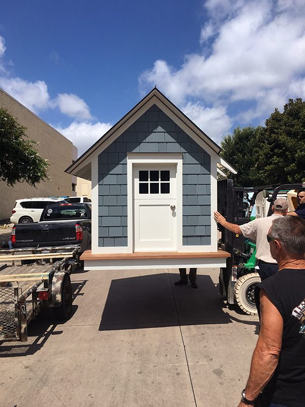 Unloading the Cottage House at the mall
