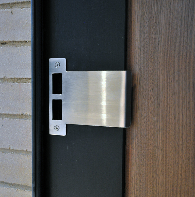 off center pivot door - custom strike plate