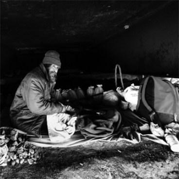 Homeless Man living under a bridge
