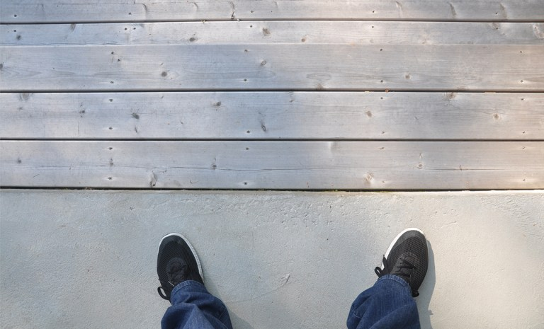 transition from the concrete terrace to the wood deck steps
