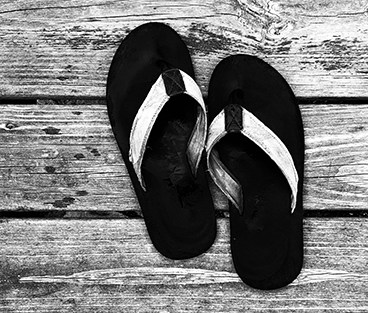 flip flops on a wooden deck