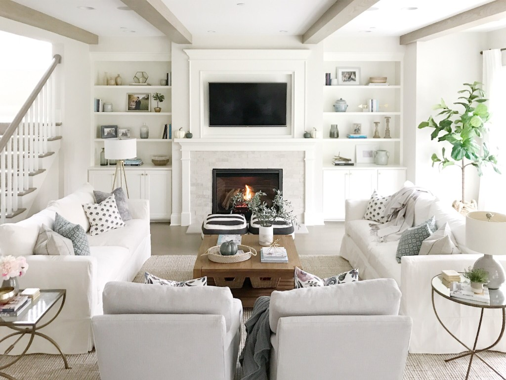 Open concept living room life on cedar lane - Living room with fireplace ...