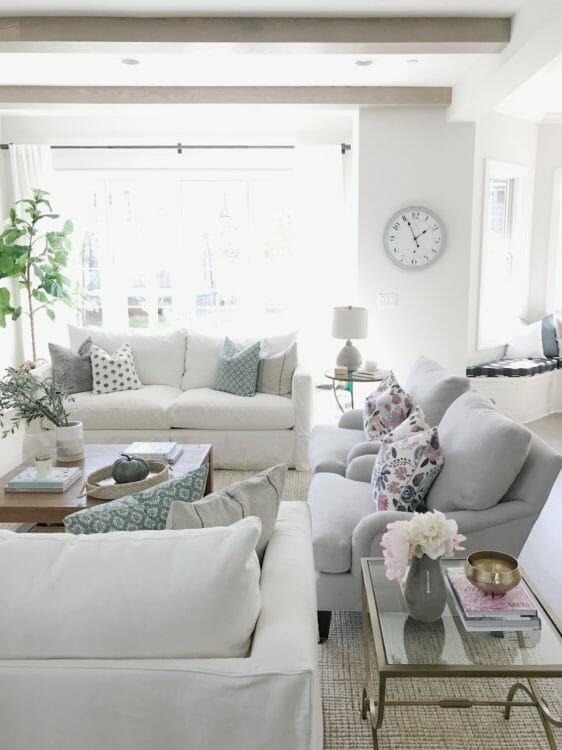 white couch neutral living room open concept classic gray living room beams