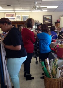 women buying clothes at upscale resale store