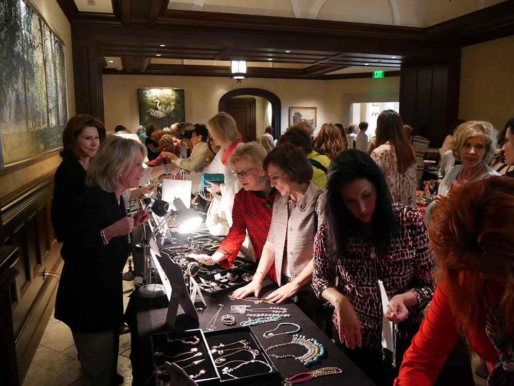 women looking at jewelry at Lifesavers Foundation luncheon and boutique