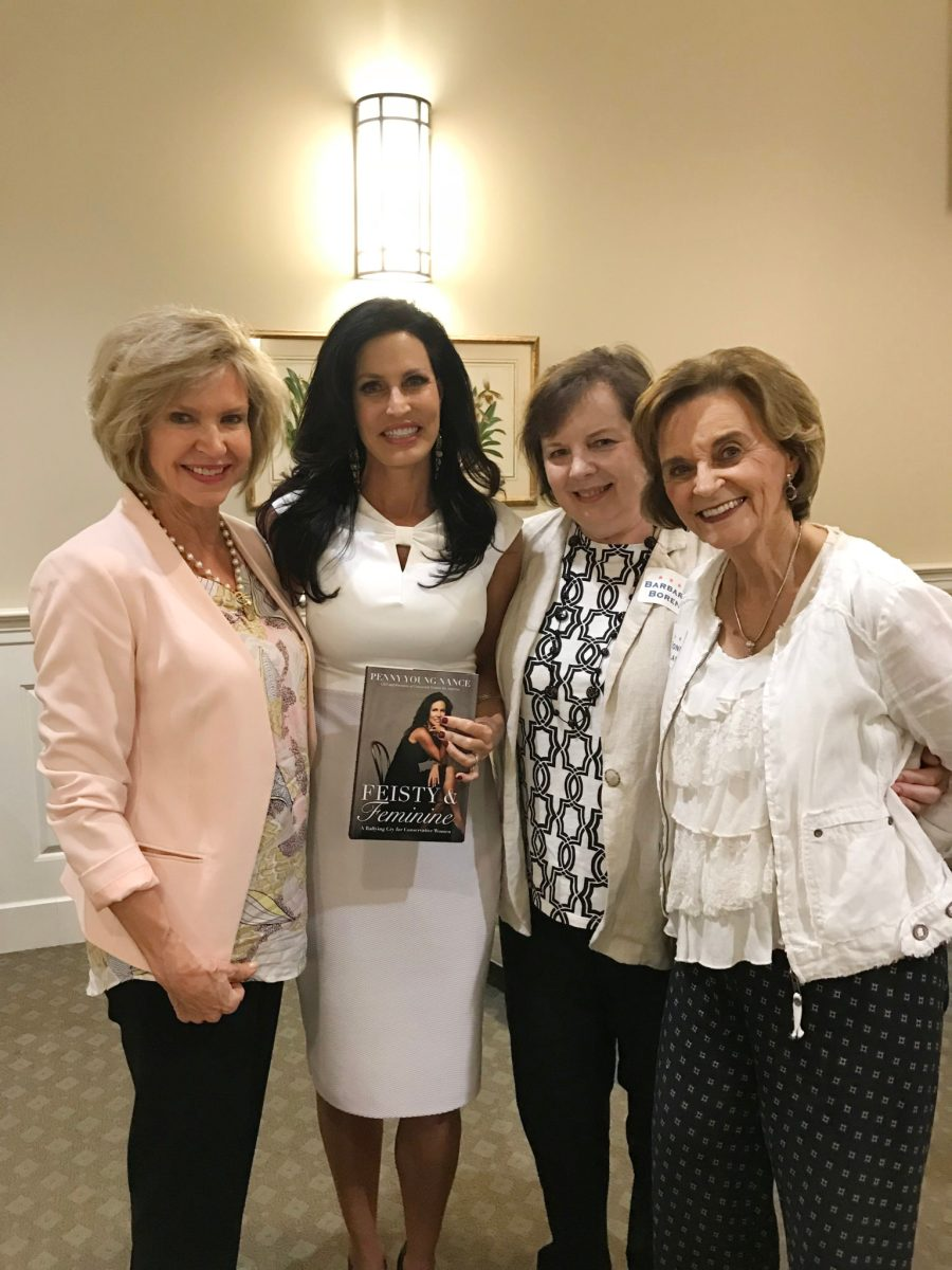 Penny Nance with LifeSavers Foundation board members and her book