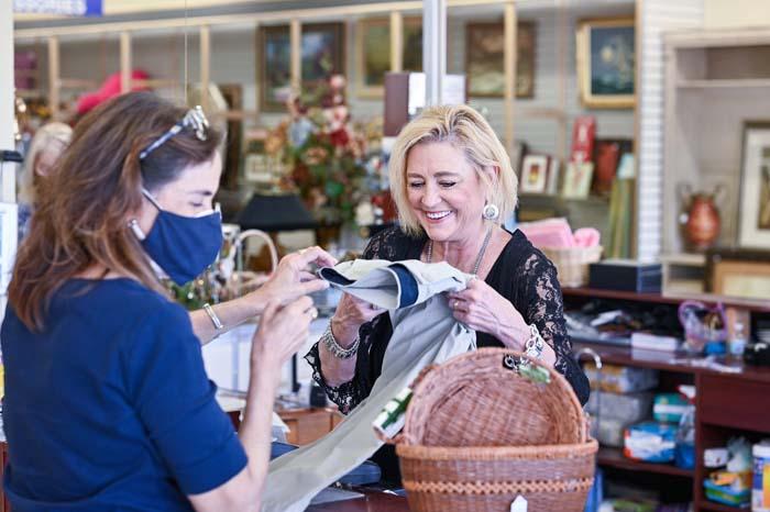 upscale resale employee with customer