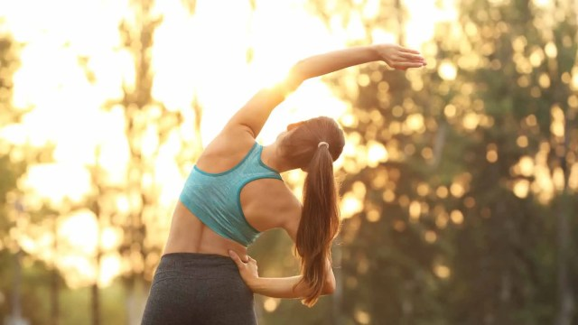 Woman stretching in the summer sun