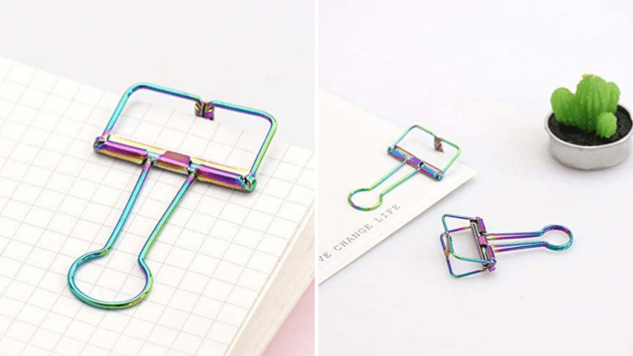 A holographic gym clips hold back notebook pages.